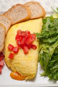 Cheese ometette with tomato and salad Stock Photos
