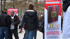 Salafist Salafi promoting Koran at Zeil shopping district Frankfurt Germany Stock Footage