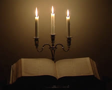 Wax candles and Bible Stock Footage