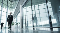 Diverse group of business people in a light and modern office building - stock footage