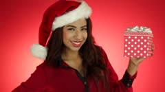 Young pretty Hispanic Woman holds the gift box in her hand - stock footage
