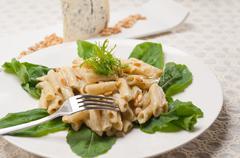 Italian pasta penne gorgonzola and pine nuts Stock Photos