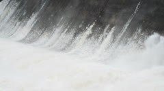 Water rapidly flows over the spillway Stock Footage