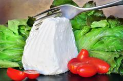 Fresh ricotta cheese cut with fork Stock Photos