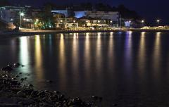 night village sea - stock photo