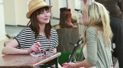 Cheerful women at the table outdoors talking (1/2) - stock footage