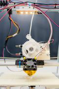 Stock Photo of electronic three dimensional plastic printer during work in school laboratory