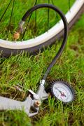 bicycle and air compressor - stock photo