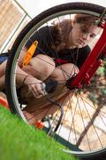 Bicycle and air compressor Stock Photos