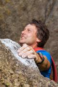 Climber during climbing the mountain Stock Photos