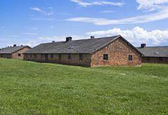 barracks for women in auschwitz-birkenau concentration camp - stock photo