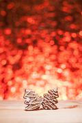 Stock Photo of christmas gingerbread with red blurred background