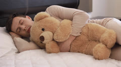 Guy is sleeping with teddy bear (PAL) Stock Footage