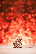 christmas gingerbread with red blurred background - stock photo