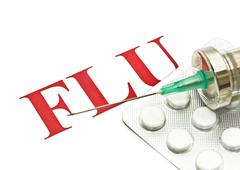 Stock Photo of swine flu h1n1 - closeup of pills and syringe
