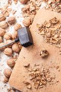 shelling walnuts in the kitchen - stock photo