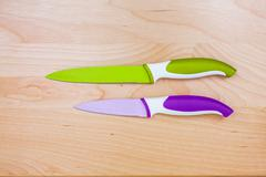 top view on color knife on wooden background with copyspace - stock photo
