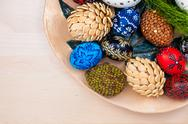Stock Photo of top view of easter eggs in wooden bowl on wooden backgroud