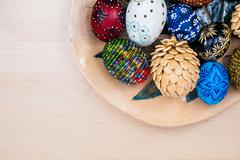top view of easter eggs in wooden bowl on wooden backgroud - stock photo