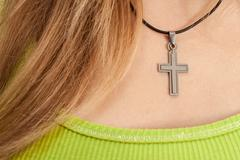 christian woman with cross necklace - stock photo