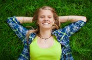 Stock Photo of young girl relaxing in grass