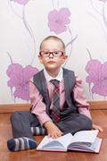 Sitting little boy with diary looks like a business man Stock Photos