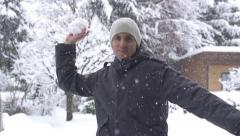 SLOW MOTION: Young man throwing a snowball Stock Footage