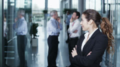 Diverse group of business people in a light and modern office building Stock Footage