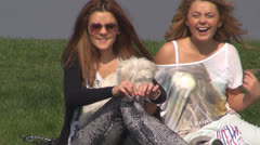 Girls talking and laughing in the park.With dogs on green grass. Stock Footage