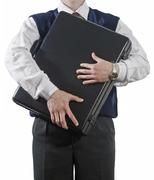 businessman clasping case to breast - stock photo