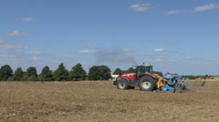 Tractor seeding a field in northern France. Stock Footage