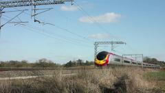 Pendolino tilting passenger train on the West Coast mainline railway England Stock Footage