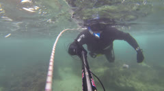 Spear fisherman spearfishing underwater Stock Footage