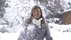 SLOW MOTION: Woman hit by snowball - stock footage