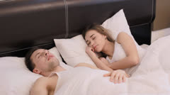 Guy snores and annoys his girlfriend (PAL) Stock Footage