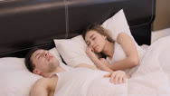 Stock Video Footage of Guy snores and annoys his girlfriend (PAL)
