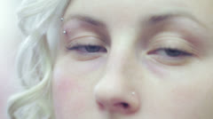 Woman looks around with her blue eyes - macro Stock Footage