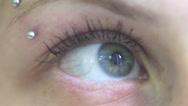 Young woman blu eye - macro Stock Footage