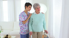 Asian nurse and elderly patient looking out window - stock footage