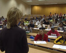 Lecturer in lecture room with students. Stock Footage