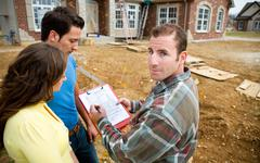 Construction: going over plans with homeowner Stock Photos