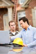 Construction: architect finds issue with plans Stock Photos