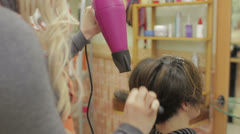Stock Video Footage of Girl gets a hairdo  - hairdresser - hairstylist