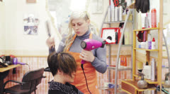 A hairdressers shop during the day - hairdresser - hairstylist Stock Footage