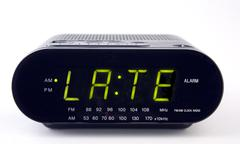 Clock radio with the word late Stock Photos
