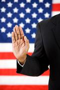 Politician: hand raised to take an oath Stock Photos