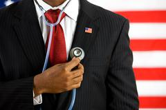 politician: holding a stethoscope medical concept - stock photo