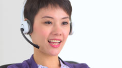 Chinese businesswoman speaking with a client Stock Footage