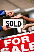 Home: agent hands keys to new homeowner Stock Photos