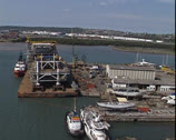 Stock Video Footage of Aerial shot of oil platform topsides on barge in Durban harbour